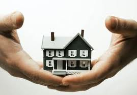 two hands holding lease to own home